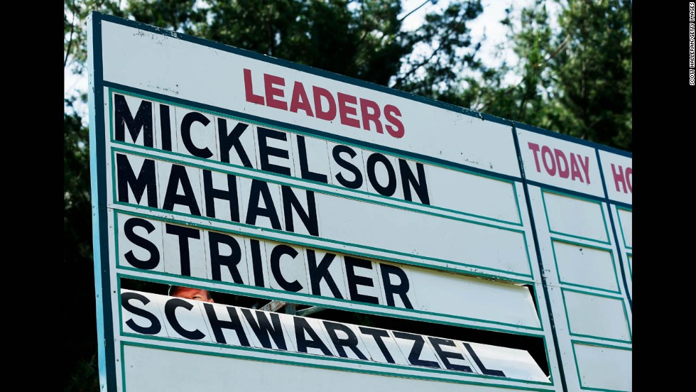 The names of Phil Mickelson of the United States, Hunter Mahan of the United States, Steve Stricker of the United States and Charl Schwartzel of South Africa are seen on a leaderboard during the final round on June 16.