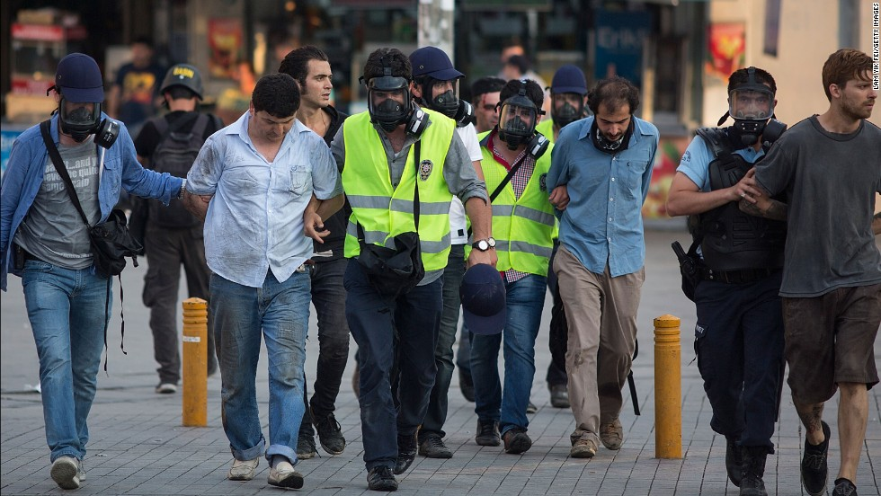 Police detain protesters after a crackdown on a demonstration at Istanbul's Gezi Park on June 16.