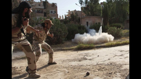 Members of the Free Syrian Army fire a homemade rocket toward regime forces in Deir al-Zor on Sunday, June 16.