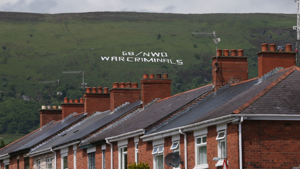 Giant letters on a hillside overlooking Belfast, Northern Ireland, display a message from protesters on June 17.