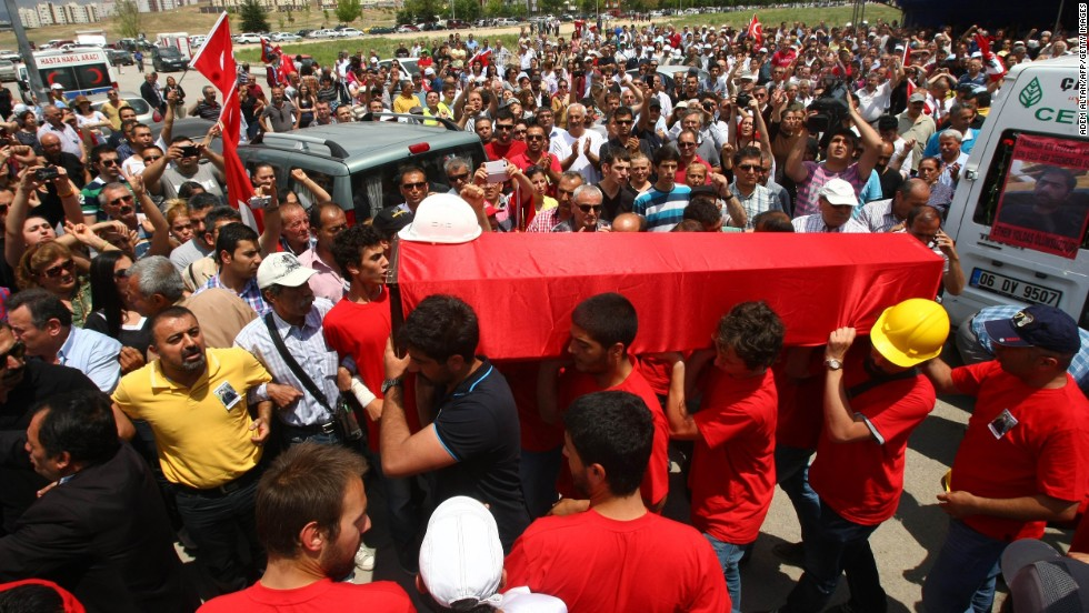People carry the coffin of Ethem Sarisuluk, who was killed during recent protests in Turkey, on Sunday, June 16, in Ankara.