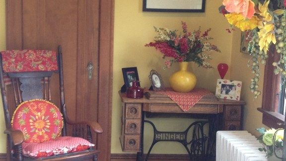 "Jill Deane's ""vibrant-eclectic"" style continues from her front porch into the foyer of her 1920s home."