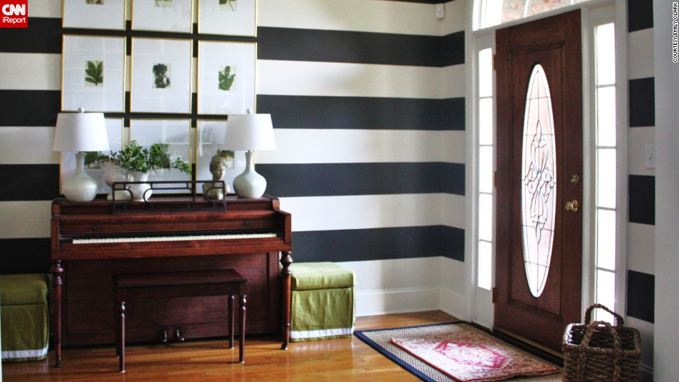 "<a href=""http://ireport.cnn.com/docs/DOC-986389"">Emily Clark'</a>s bold, striped foyer -- which also functions as a music room -- in Charlotte, North Carolina, is a playful take on formal decor."