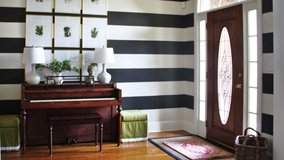 Emily Clark's bold, striped foyer -- which also functions as a music room -- in Charlotte, North Carolina, is a playful take on formal decor.