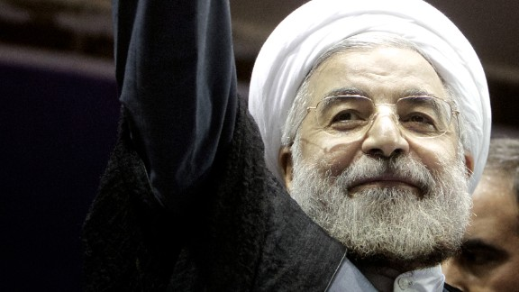 Hassan Rouhani, a moderate Iranian presidential candidate and former top nuclear negotiator, waves as he attends his campaign rally in downtown Tehran on June 8, 2013.