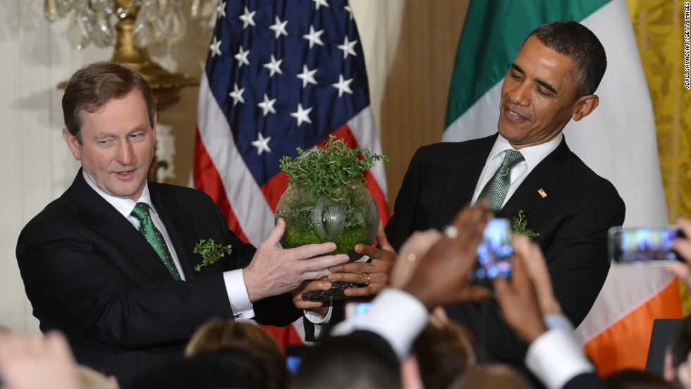 Kenny presents  a bowl of shamrocks to Obama during a St. Patrick's Day reception at the White House in March.