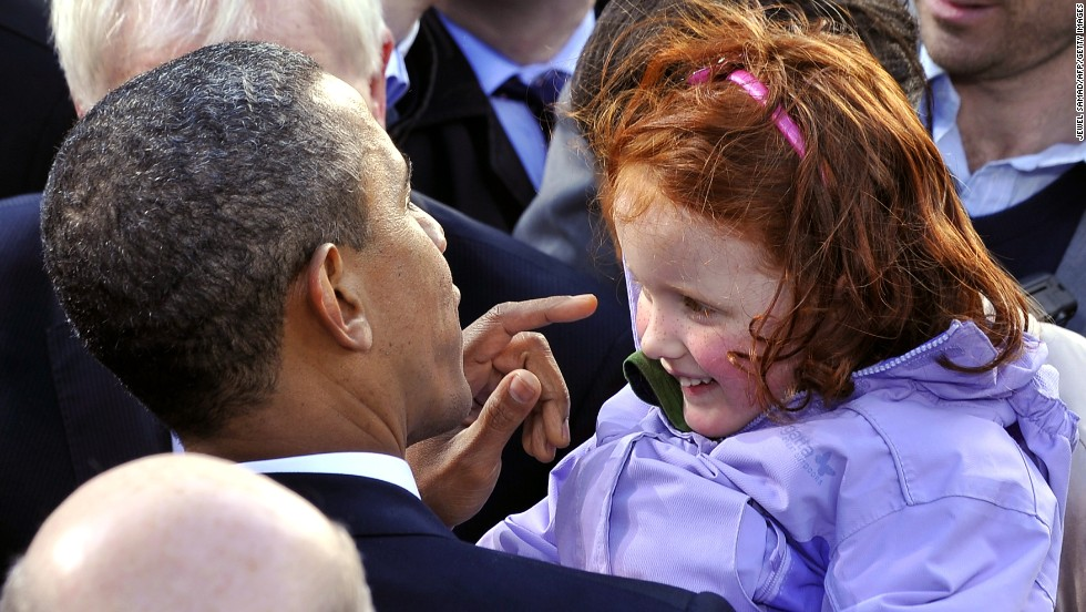 Obama greets a young fan during a rally in Dublin on May 23, 2011.