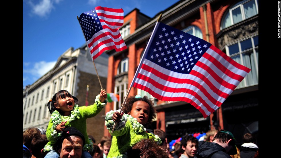 Children wave U.S. flags as they wait for Obama at a rally at College Green in Dublin on May 23, 2011.