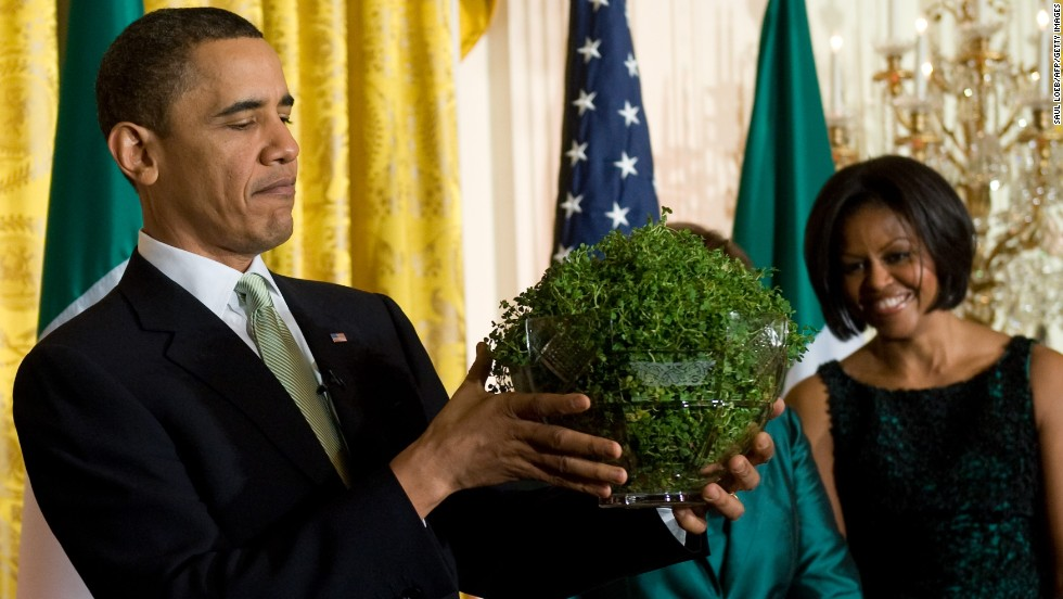 Obama holds a bowl of shamrocks presented to him by Prime Minister Brian Cowen of Ireland during a St. Patrick's Day reception at the White House on May 17, 2011.