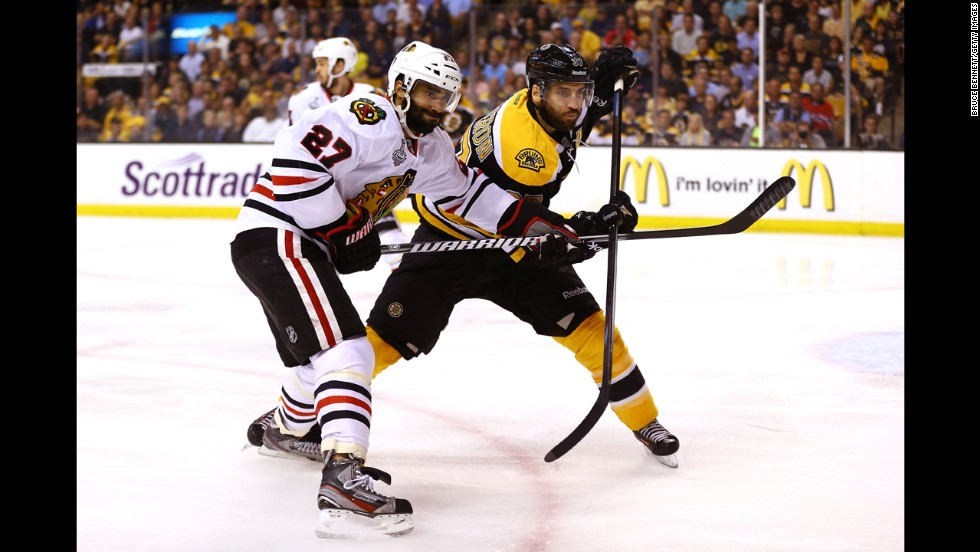 Patrice Bergeron of the Boston Bruins fights for position with Johnny Oduya of the Chicago Blackhawks in the first period.