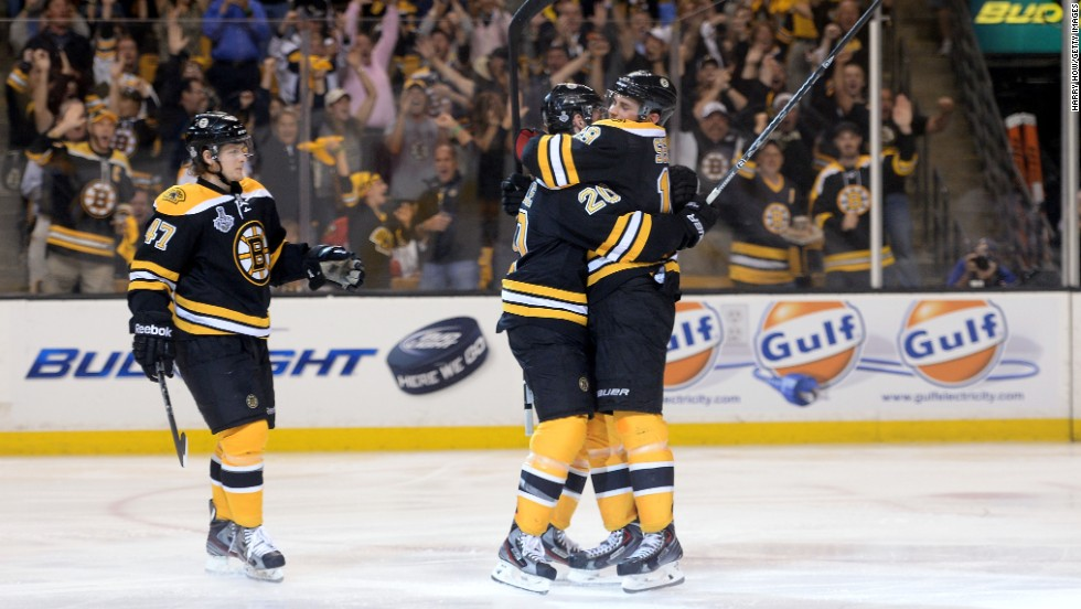 Daniel Paille, center, of the Boston Bruins is congratulated by Tyler Seguin, right, and Torey Krug after scoring the first goal of the game in the second period against the Chicago Blackhawks.