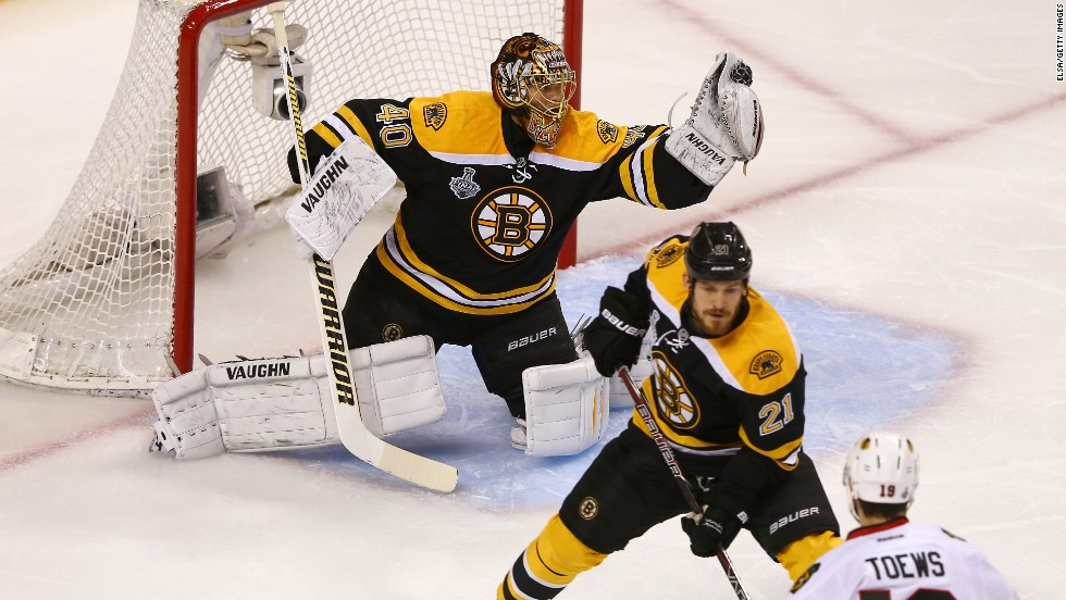Tuukka Rask of the Boston Bruins makes a glove save against the Chicago Blackhawks in Game 3.