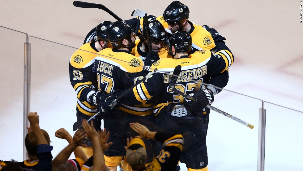 "Patrice Bergeron of the Boston Bruins celebrates with teammates after scoring the second goal of the game against the Chicago Blackhawks during Game 3 of the 2013 NHL Stanley Cup Finals on Monday, June 17, in Boston. The Bruins beat the Blackhawks 2-0 and lead the series 2-1. <a href=""http://www.cnn.com/2013/06/15/us/gallery/stanley-cup-game-2/index.html"">See photos from Game 2</a>."