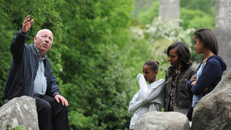 Michelle Obama, accompanied by her two daughters, Sasha, left, and Malia, right, visits Glendalough with tour guide George McClafferty in the Wicklow Mountains National Park in Ireland on Tuesday, June 18. The Obama girls are making stops around the country to learn about their Irish heritage while the president attends the G8 Summit.