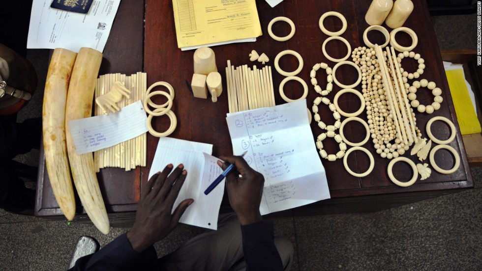 A police officer catalogs illegal ivory found in the possession of four Chinese men in Nairobi, Kenya, in January, 2013. The men pleaded guilty to smuggling thousands of dollars worth of ivory and were fined just $340 each. The loot included 40 chopsticks, six necklaces, bracelets and a pen holder, as well as raw ivory that had a black market value of $24,000 in Asia.