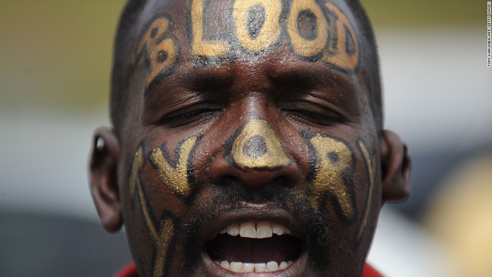 "A man with the words ""Blood Ivory"" painted on his face protests in Nairobi with a group called Kenyans United Against Poaching."
