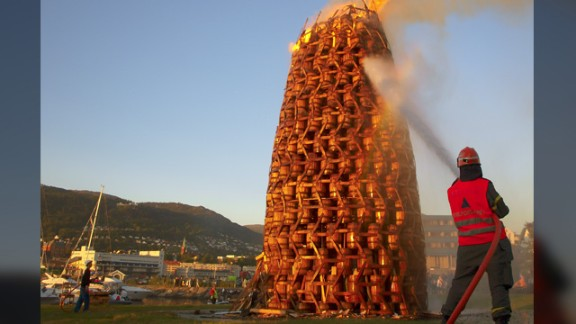 "The bonfires are also one of the highlights during Norwegian midsummer, or 'Sankthansaften'. This photo taken by Jon-Arne Belsaas in 2009 shows one of the world's largest bonfire made of barrels. He had hurried back to the town of Bergen from his work on a Navy ship to witness it. ""I wanted to catch this magnificent sight,"" he says."