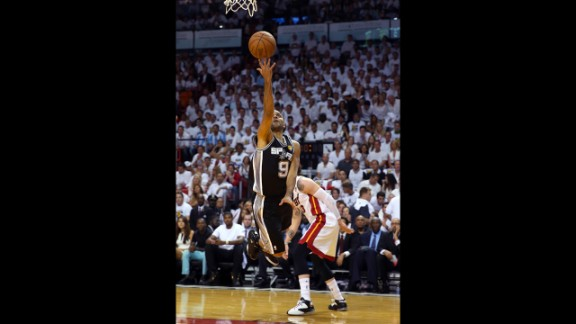 Tony Parker of the San Antonio Spurs goes up for a shot against Mike Miller of the Miami Heat in the first quarter.