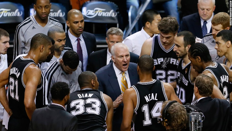 Spurs head coach Gregg Popovich coaches his team during a timeout in the first half against the Miami Heat.