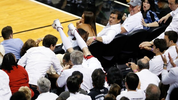 Chris Andersen of the Miami Heat dives into the seats chasing a ball in the second quarter against the San Antonio Spurs.