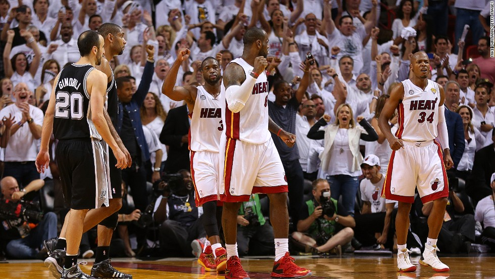 "Dwyane Wade, back, LeBron James, center, and Ray Allen of the Miami Heat celebrate after defeating the San Antonio Spurs during Game 6 of the 2013 NBA Finals on Tuesday, June 18, in Miami. The Heat beat the Spurs 103-100 to tie the series 3-3. <a href=""http://www.cnn.com/2013/06/16/us/gallery/nba-finals-game-5/index.html"">See photos from Game 5.</a>"
