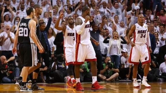 Dwyane Wade, back, LeBron James, center, and Ray Allen of the Miami Heat celebrate after defeating the San Antonio Spurs during Game 6 of the 2013 NBA Finals on Tuesday, June 18, in Miami. The Heat beat the Spurs 103-100 to tie the series 3-3. See photos from Game 5.