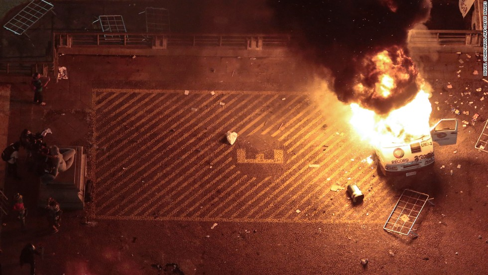 A press car burns in front of Sao Paulo City Hall on June 18.