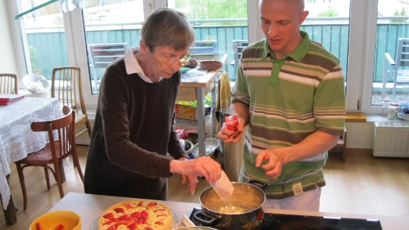 Tenant Dorothea Straube-Koberstein bakes a cake with Christoph Remmlinger, a personal care assistant, at a shared apartment for seniors in Potsdam, Germany.