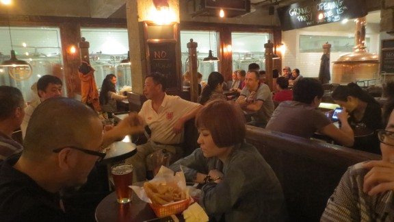 Customers at Greap Leap microbrewery on Xinzhong Street in Beijing.