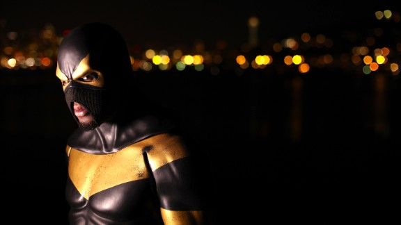 """Phoenix Jones, a Seattle real life superhero, patrols the city streets at night dressed in a $10,000 bulletproof, Kevlar reinforced supersuit. He leads a global network of superheroes called The Alliance, with members in New York, London and Dubai. The so-called """"Guardian of Seattle"""" has been shot at and stabbed twice, but has also been documented stopping crimes."""