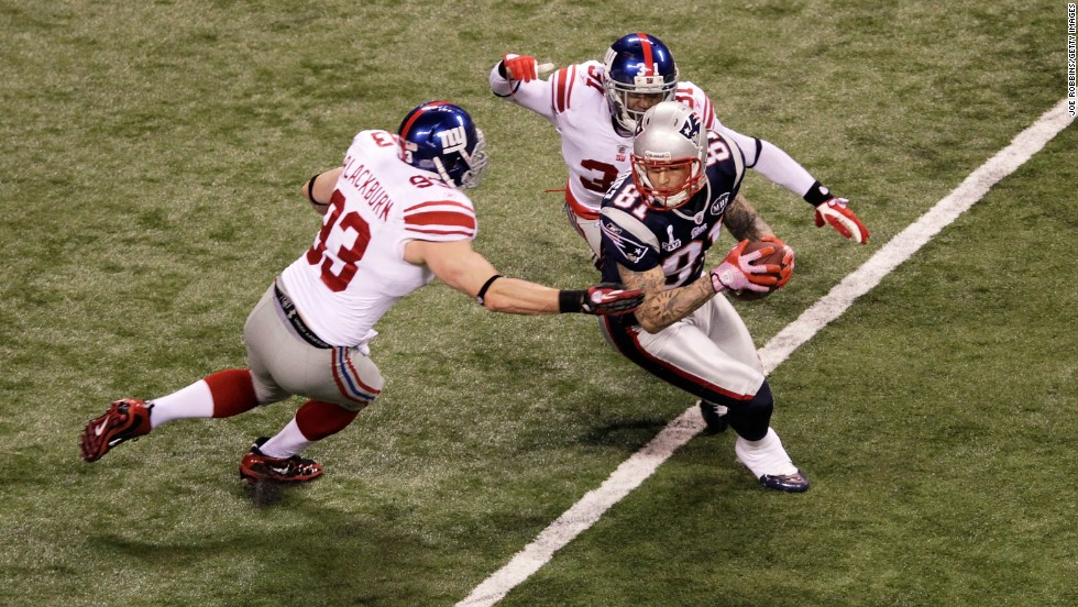Hernandez catches a pass against Chase Blackburn and Aaron Ross of the New York Giants during Super Bowl XLVI on February 5, 2012, in Indianapolis.