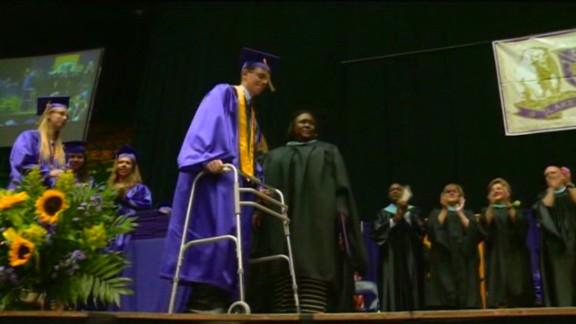 dnt paralyzed teen walks at graduation_00004717.jpg