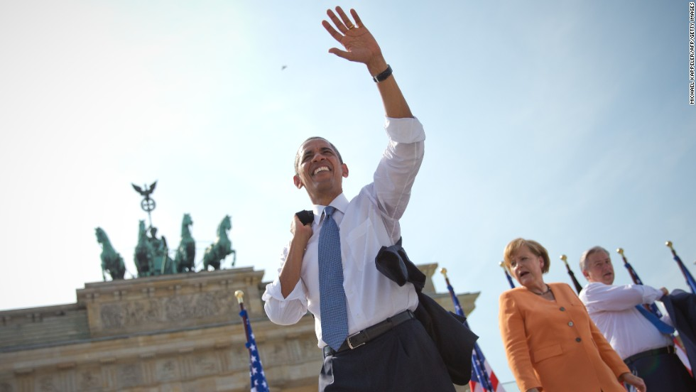 "JUNE 20, BERLIN, GERMANY: <a href=""http://cnn.com/2013/06/19/politics/obama-nuclear-cuts/index.html"">President Barack Obama waves to crowds</a> in front of Berlin's landmark Brandenburg Gate. Obama took the stage <a href=""http://cnn.com/2013/06/18/opinion/mills-jfk-berlin-speech/index.html"">50 years after John F. Kennedy's famous ""Ich bin ein Berliner"" speech</a>, in which he praised the citizens of West Berlin for their refusal to be intimidated by the wall that had divided their city."