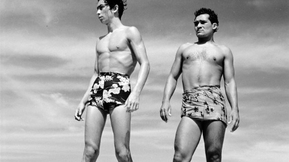 Swimmers in Acapulco, Mexico, show off Hawaiian print swimming trunks in 1950.