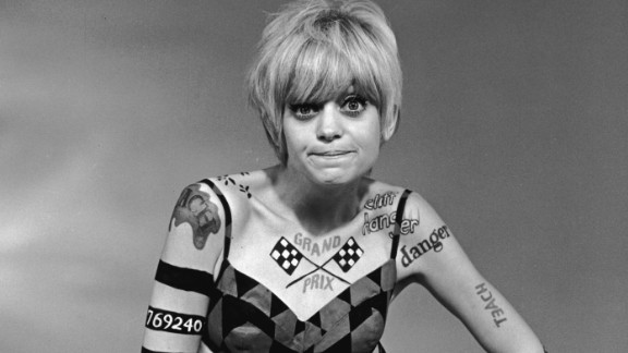 """By the end of the decade, California beach style took a psychedelic spin with graphic prints and barely-there bikinis. Body paint, as worn by Goldie Hawn on """"Laugh-In,"""" rounds out the look."""