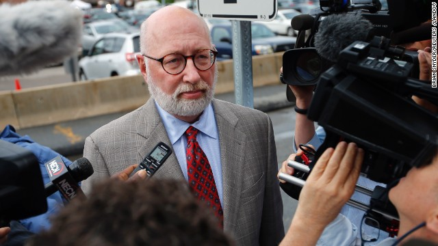 "Image #: 22721487    J.W. Carney, defense attorney for accused mob boss James ""Whitey"" Bulger, talks to reporters as he arrives at the U.S. Federal Courthouse for the start of Bulger's trial in Boston, Massachusetts June 12, 2013. The long-awaited trial of Bulger, who evaded an FBI hunt for 16 years before his arrest in 2011, starts on Wednesday with opening statements from prosecutors and defense attorneys. Bulger is accused of committing or ordering 19 murders while running Boston's ""Winter Hill"" crime gang in the 1970s and 80s.   REUTERS/Brian Snyder  (UNITED STATES - Tags: CRIME LAW)       REUTERS /BRIAN SNYDER /LANDOV"