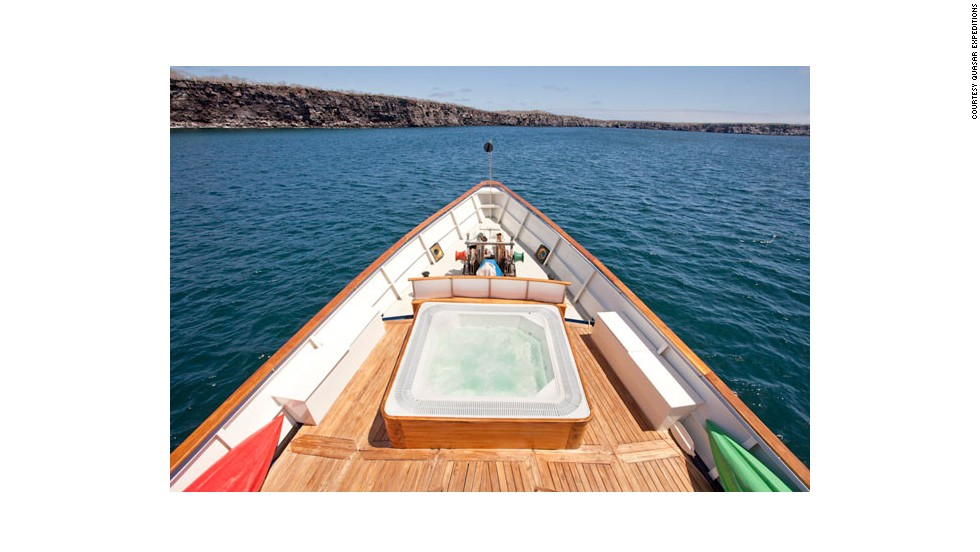 Today, the luxurious boat has been refitted with nine staterooms and a top-deck hot tub. Guests can enjoy fine dining as the yacht winds its way around the exotic Galapagos Islands.