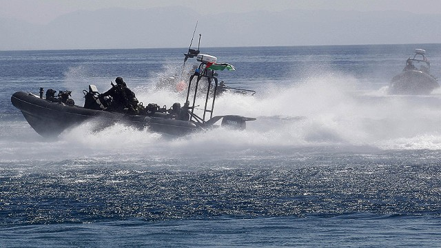 "A zodiac motors past during the ""Eager Lion"" military exercise in the Red Sea off the coast of Aqaba, some 330 km south of the Jordanian capital Amman, on June 19, 2013. Some 8,000 personnel from 19 different nations are participating in the exercise in Jordan from June 9 to June 20, according to officials. AFP PHOTO/KHALIL MAZRAAWIKHALIL MAZRAAWI/AFP/Getty Images"