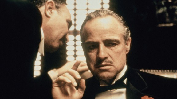 """The Godfather"": Mario Puzo's 1969 novel chronicles the history of an immigrant and his family making their way in America as part of the Italian Mafia. It was made into an Oscar-winning 1972 film with Marlon Brando, and then expanded for 1974 and 1990 sequels."