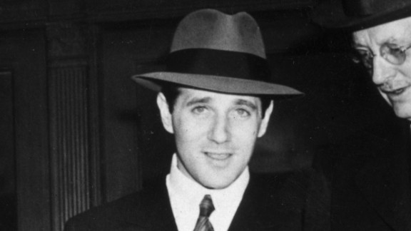 """Benjamin """"Bugsy"""" Siegel, at center with two unidentified men, established crime syndicate-controlled gambling in Las Vegas."""