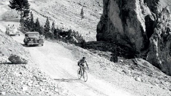 Legendary Italian rider Gino Bartali rides in splendid isolation on the Col d