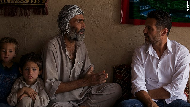 Writer Khaled Hosseini, right, visits Afghanistan as a goodwill envoy for the U.N. Refugee Agency.