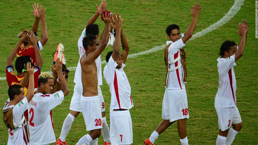 Tahiti's players lap up the acclaim from the stands at the end of the match.