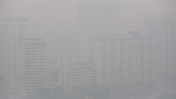 Apartment buildings were shrouded in a haze of smoke on Wednesday, June 19, in Singapore.  The city-state