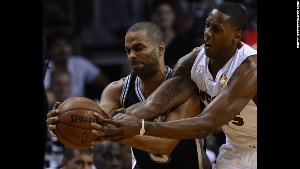 Mario Chalmers of the Miami Heat fouls Tony Parker of the San Antonio Spurs.