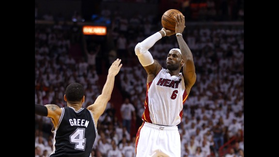 LeBron James of the Miami Heat makes a three-pointer over Danny Green of the San Antonio Spurs in the second quarter.