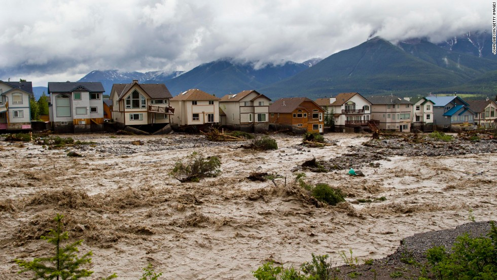 The waters of Cougar Creek expand through a neighborhood in Canmore, west of Calgary, on June 20.