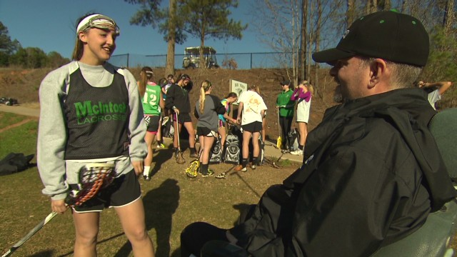 Girls' lacrosse team helps ALS coach
