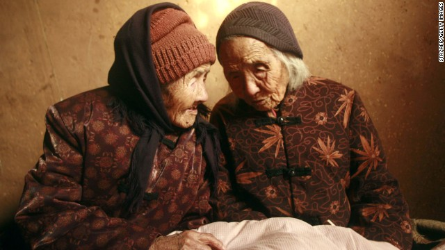 Chinese twins Cao Xiaoqiao, left, and Cao Daqiao were 104 when this photo was taken in 2009.