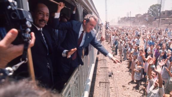 President Richard Nixon and Egyptian President Anwar Sadat greet people in Egypt, in June 1974.